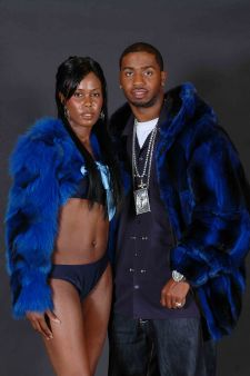 "Marc Kaufman Furs presents a men's blue Chinchilla Bomber and a Women""s Blue Bolero Fox Jacket in New York City"