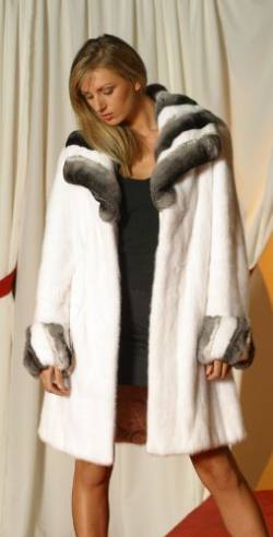 Marc Kaufman Furs Presents a white mink fur stroller with chinchilla collar and cuffs from Marc Kaufman Furs New York,Fur coats in Argentina, fur coats in Chile, fur coats in Venezuela, fur coats in Australia, fur coats in Belgium,fur coats in Netherlands, fur coats in Norway,fur coats in Sweden,fur coats in Dubais,fur coats in Egypt,fur coats in Egypt,fur coats in Kuwait, fur coats in South Africa,fur coats in Tunisia,fur coats in the Falklands