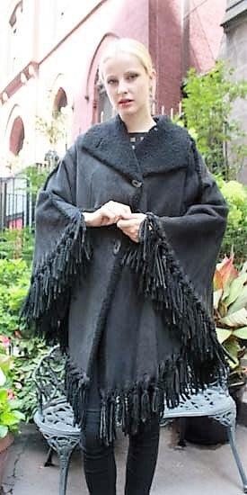 Marc Kaufman Furs Presents a charcoal gray shearling cape from Marc Kaufman Furs New York,Argentina,United Kingdom,Austria,Denmark,Norway,Australia,Finland,Saudi Arabia,Oman,Kuwait,Jordan,Egypt