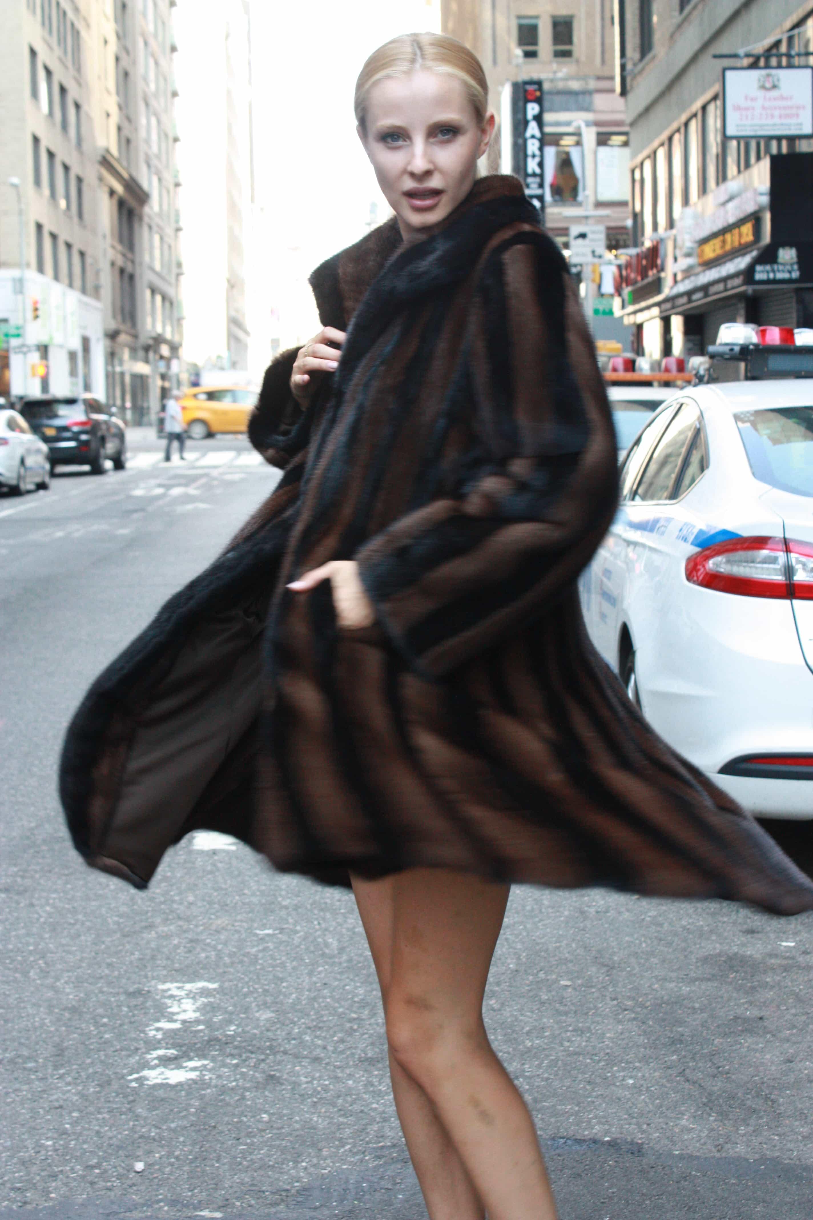 Marc Kaufman Furs Presents a black and brown mink fur swing stroller from Marc Kaufman Furs New York,Argentina,United Kingdom,Austria,Denmark,Norway,Australia,Finland,Saudi Arabia,Oman,Kuwait,Jordan,Egypt