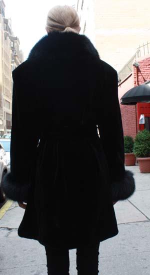 Marc Kaufman Furs Presents a black sheared mink fur stroller with black fox collar cuffs and belt from Marc Kaufman Furs New York,Argentina,United Kingdom,Austria,Denmark,Norway,Australia,Finland,Saudi Arabia,Oman,Kuwait,Jordan,Egypt
