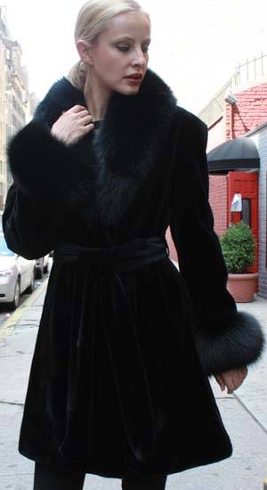 Marc Kaufman Furs Presents a black sheared mink fur stroller with black fox collar cuffs and belt from Marc Kaufman Furs New York,Argentina,United Kingdom,Austria,Denmark,Norway,Australia,Finland,Saudi Arabia,Oman,Kuwait,Jordan,Egypt