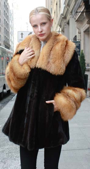 Marc Kaufman Furs Presents a blackglama mink fur stroller with red fox fur collar and red fox fur cuffs from Marc Kaufman Furs New York,Argentina,United Kingdom,Austria,Denmark,Norway,Australia,Finland,Saudi Arabia,Oman,Kuwait,Jordan,Egypt