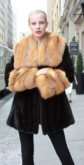 Marc Kaufman Furs Presents a blackglama mink fur stroller with red fox fur collar and red fox fur cuffs from Marc Kaufman Furs New York,Argentina,United Kingdom,Austria,Denmark,Norway,Australia,Finland,Saudi Arabia,Oman,Kuwait,Jordan,Egypt