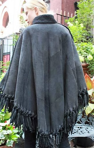 Marc Kaufman Furs Presents a charcoal gray shearling cape from Marc Kaufman Furs New York,Argentina,United Kingdom,Austria,Denmark,Norway,Australia,Finland,Saudi Arabia,Oman,Kuwait,Jordan,Egypt