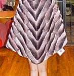 Marc Kaufman Furs presents a pink chinchilla fur poncho from Marc Kaufman Furs New York,Fur coats in Argentina, fur coats in Chile, fur coats in Venezuela, fur coats in Australia, fur coats in Belgium,fur coats in Netherlands, fur coats in Norway,fur coats in Sweden,fur coats in Dubais,fur coats in Egypt,fur coats in Egypt,fur coats in Kuwait, fur coats in South Africa,fur coats in Tunisia,fur coats in the Falklands