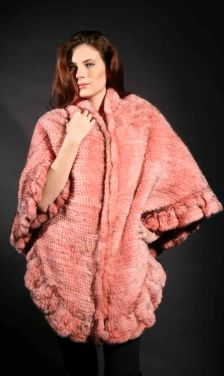 Marc Kaufman Furs Presents a pink knit mink fur cape with ruffles from Marc Kaufman Furs New York,Argentina,United Kingdom,Austria,Denmark,Norway,Australia,Finland,Saudi Arabia,Oman,Kuwait,Jordan,Egypt