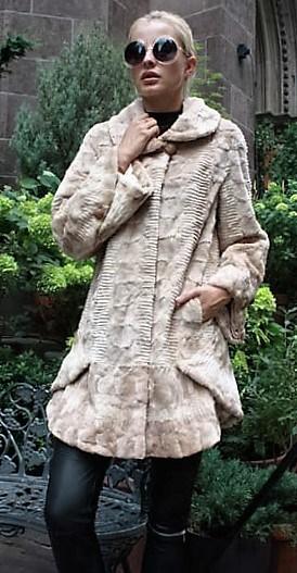 Marc Kaufman Furs Presents a ivory lazer cut sheared mink stroller from Marc Kaufman Furs New York,Argentina,United Kingdom,Austria,Denmark,Norway,Australia,Finland,Saudi Arabia,Oman,Kuwait,Jordan,Egypt