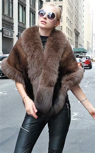 Marc Kaufman Furs Presents a brown mink fur stole with fox fur trim from Marc Kaufman Furs New York,Argentina,United Kingdom,Austria,Denmark,Norway,Australia,Finland,Saudi Arabia,Oman,Kuwait,Jordan,Egypt
