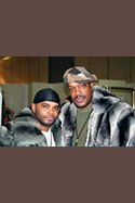 AJ Johnson Wearing Chinchilla Stroller Savior Bacote sporting a chinchilla hooded jacket