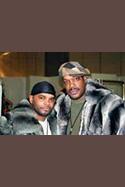 AJ Johnson Wearing Chinchilla Stroller Savior Bacote sporting a chinchilla hooded jacket