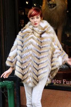 woman wearing white fox fur poncho