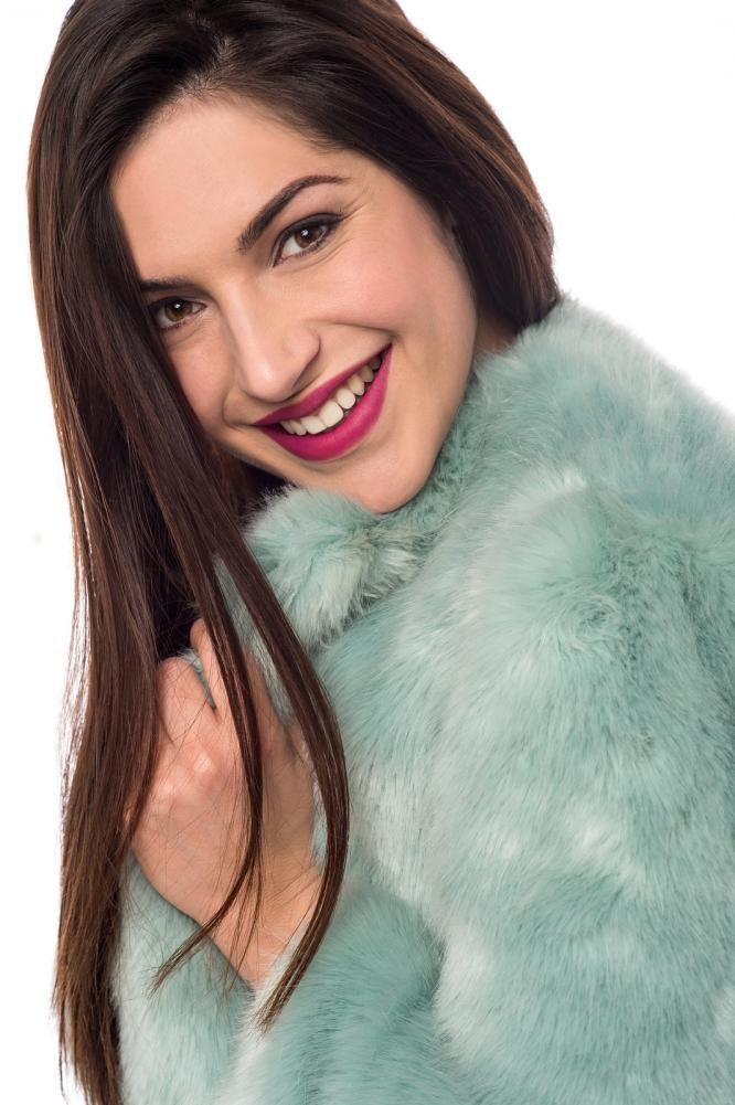 smiling woman in a fur coat