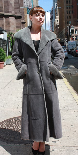 full-length coat with black heels
