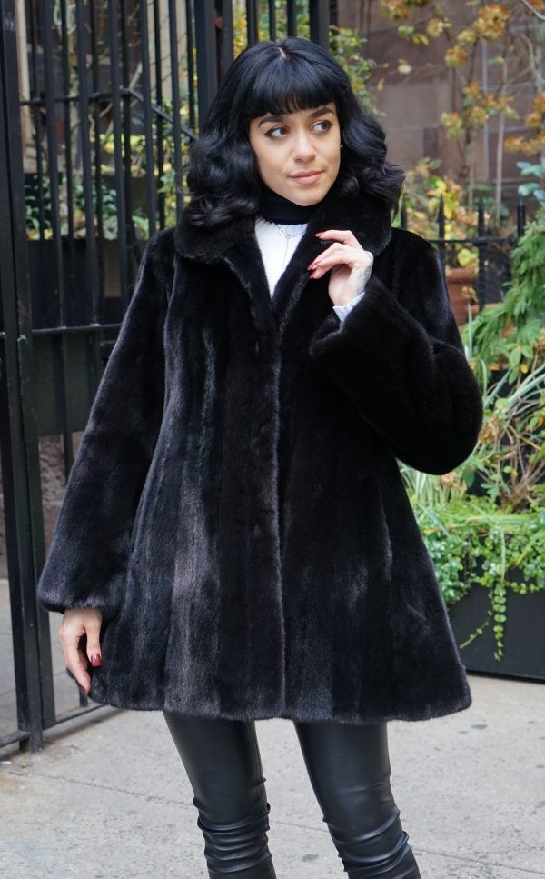 Woman Wearing a Blackglama Mink Jacket Swing