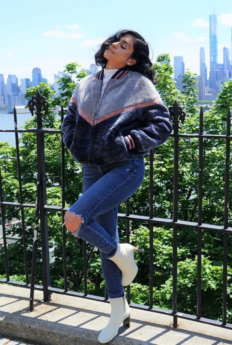 A woman wearing a shearling jacket